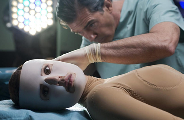 """Image from film """"The Skin I Live In"""" featuring a woman in a mask laying on a table for a cosmetic surgical procedure"""