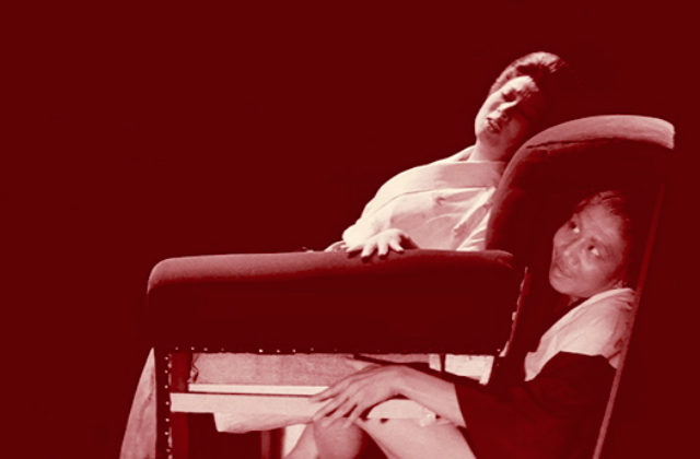 """Image of a woman sitting on a chair concealing a man inside from Japanese film """"Horrors of Malformed Men"""""""