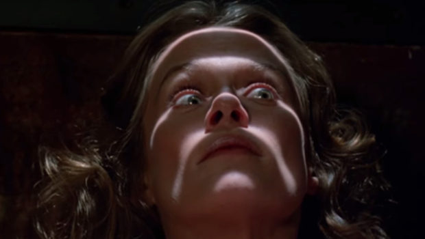 "Image still from film ""Someone's Watching Me"" featuring a close-up on a woman's face with an expression of petrified fear"